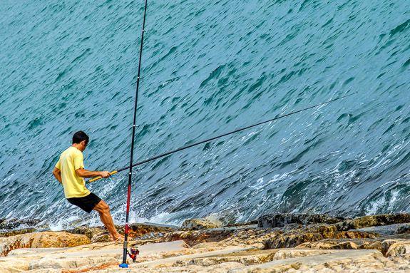 Fishing from coastal dykes near Benicarlo