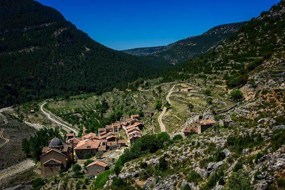 The lost village of La Estrella nestles in a valley between towering mountains