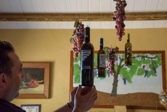 choosing a bottle to sample at Clos d'Egarracordes