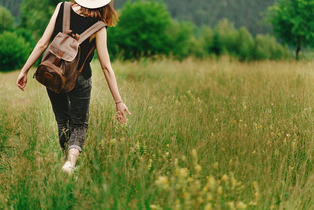 Woman walking through a meadow