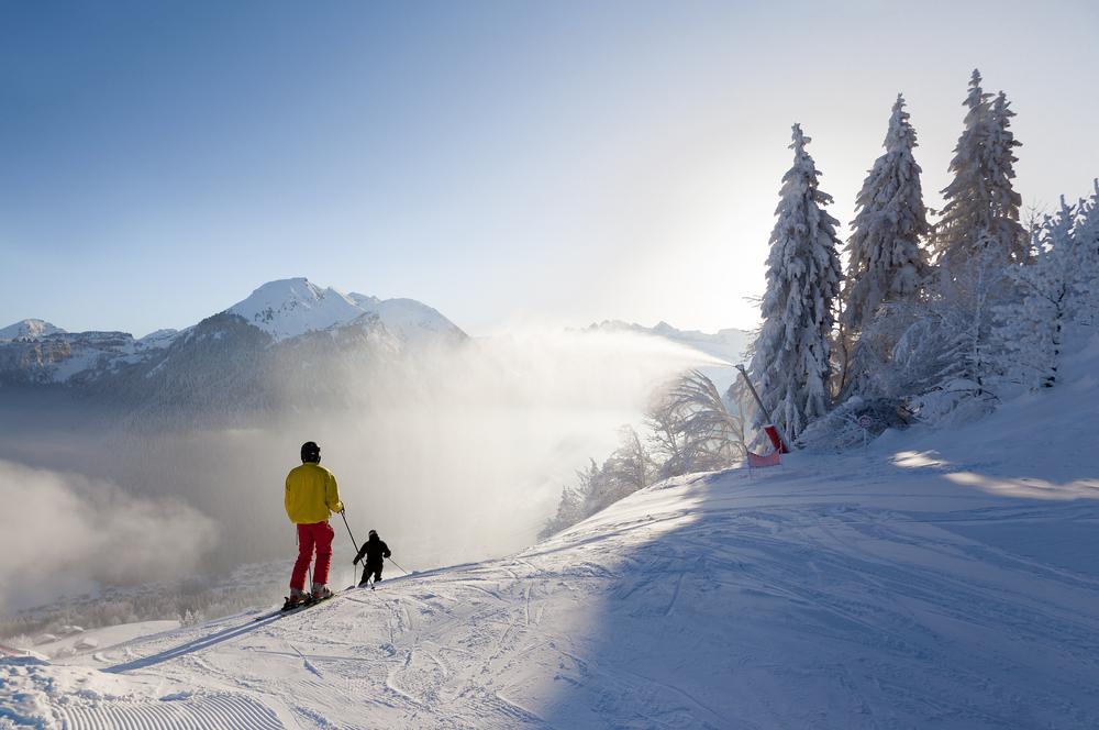 Skiers set off down a piste in the Morzine resort, part of the Portes du Soleil ski area in France.
