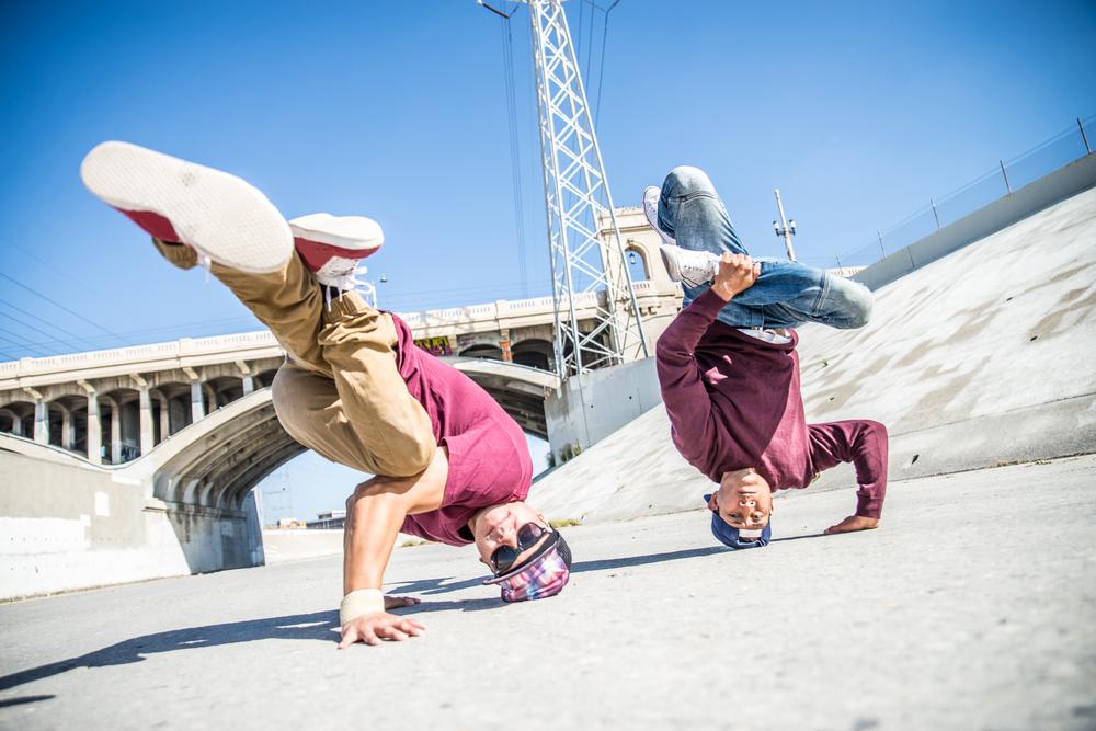 Two young men break dancing
