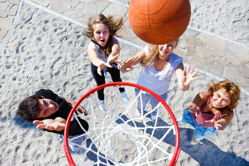 3 children playing basketball