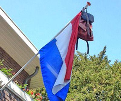 schoolbag handing from Dutch flagpole